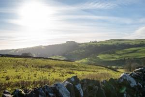 about emav peak district sunshine over green fields