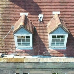 drone aerial roof inspection of historic building in warwickshire